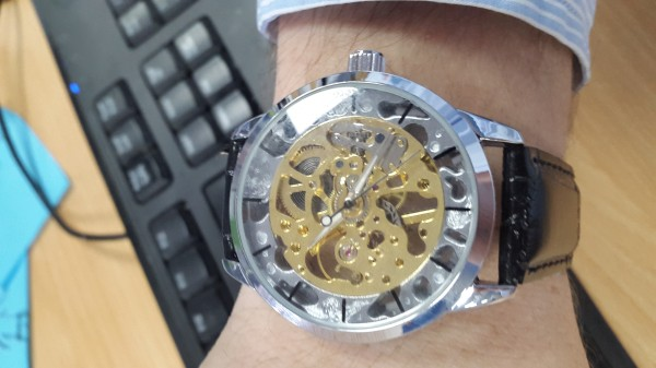 juva1 of Heavie Dutie Style wearing a Weird Ape Abbrecci Sole watch at work