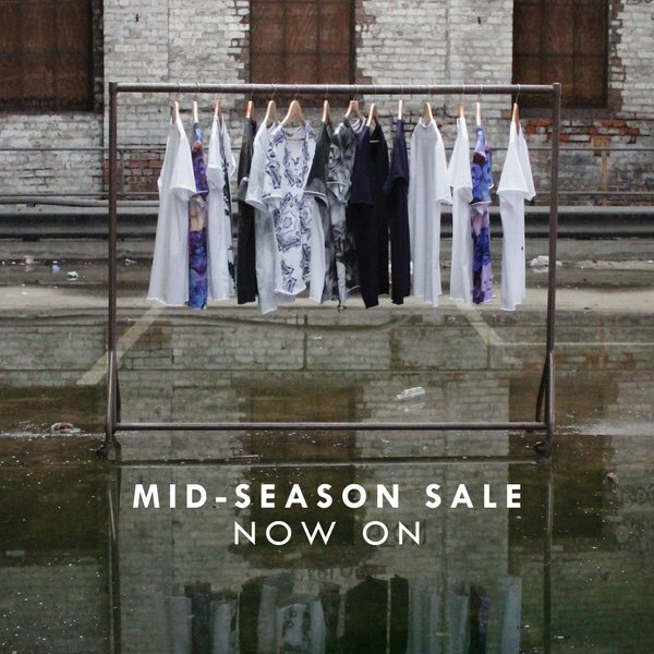 Mid season sale tees on rack run & fell